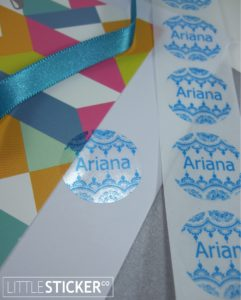 Little Sticker Co personalised clear round sticker 25mm with cyan blue print