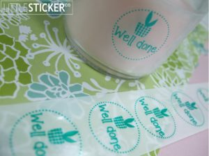 Little Sticker Co personalised clear round sticker 25mm with emerald green print